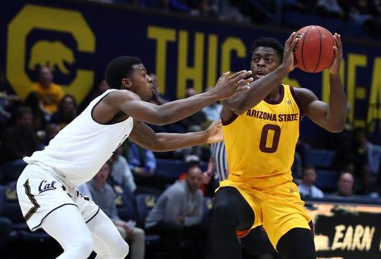 Arizona State guard Luguentz Dort, right, works the ball against California's Darius McNeill during the first half of an NCAA college basketball game Wednesday, Jan. 9, 2019, in Berkeley, Calif. (AP Photo/Ben Margot)