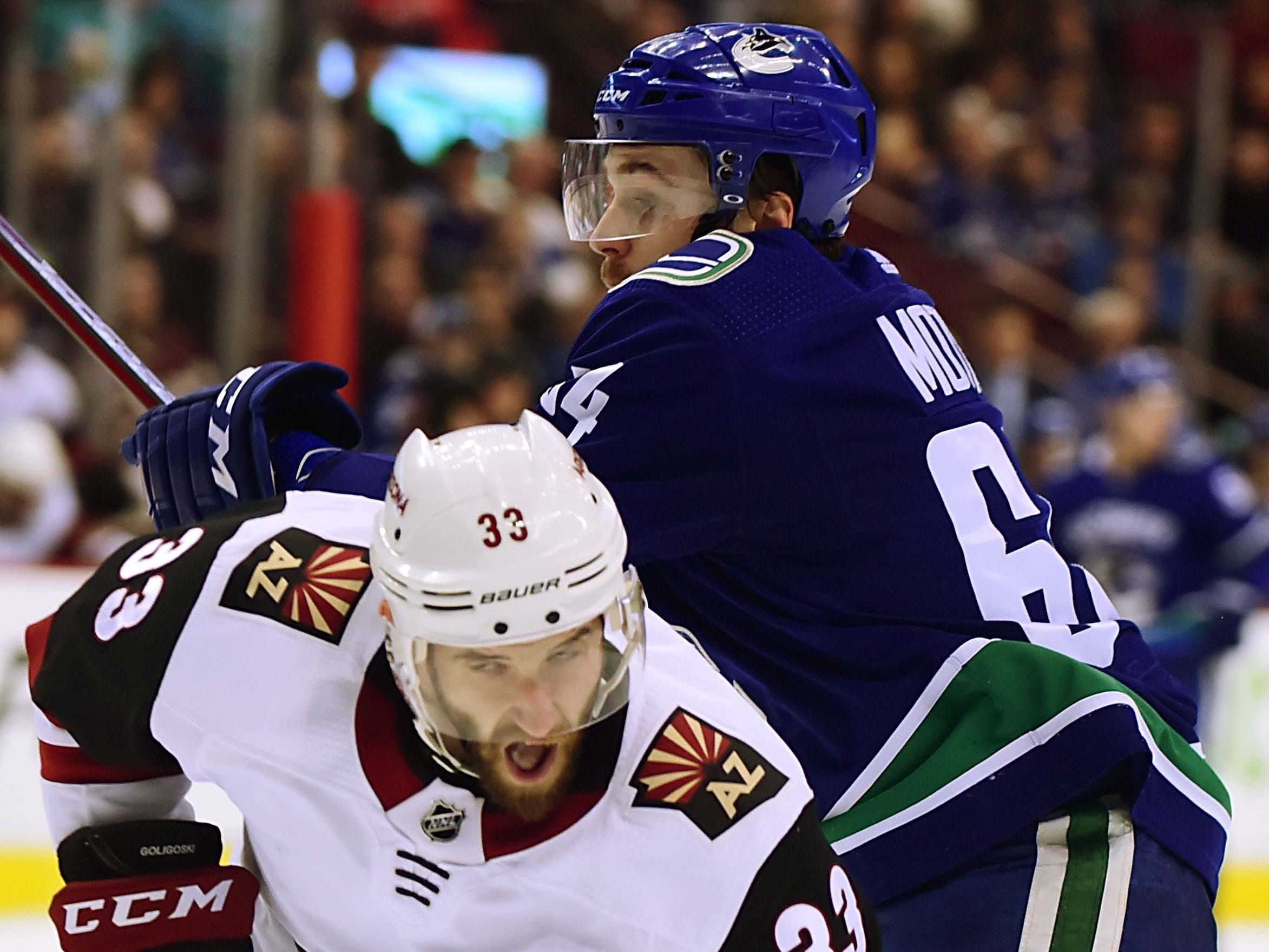Jan 10, 2019; Vancouver, British Columbia, CAN;  Arizona Coyotes defenseman Alex Goligoski (33) defends against Vancouver Canucks forward Tyler Motte (64) during the first period at Rogers Arena. Mandatory Credit: Anne-Marie Sorvin-USA TODAY Sports