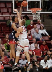 Arizona forward Ira Lee, left, dunks against Stanford forward Lukas Kisunas during the first half of an NCAA college basketball game in Stanford, Calif., Wednesday, Jan. 9, 2019. (AP Photo/Jeff Chiu)