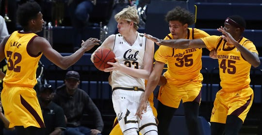 California's Connor Vanover (23) looks to pass the ball away from Arizona State's De'Quon Lake (32), Taeshon Cherry (35) and Zylan Cheatham, right, during the first half of an NCAA college basketball game Wednesday, Jan. 9, 2019, in Berkeley, Calif. (AP Photo/Ben Margot)