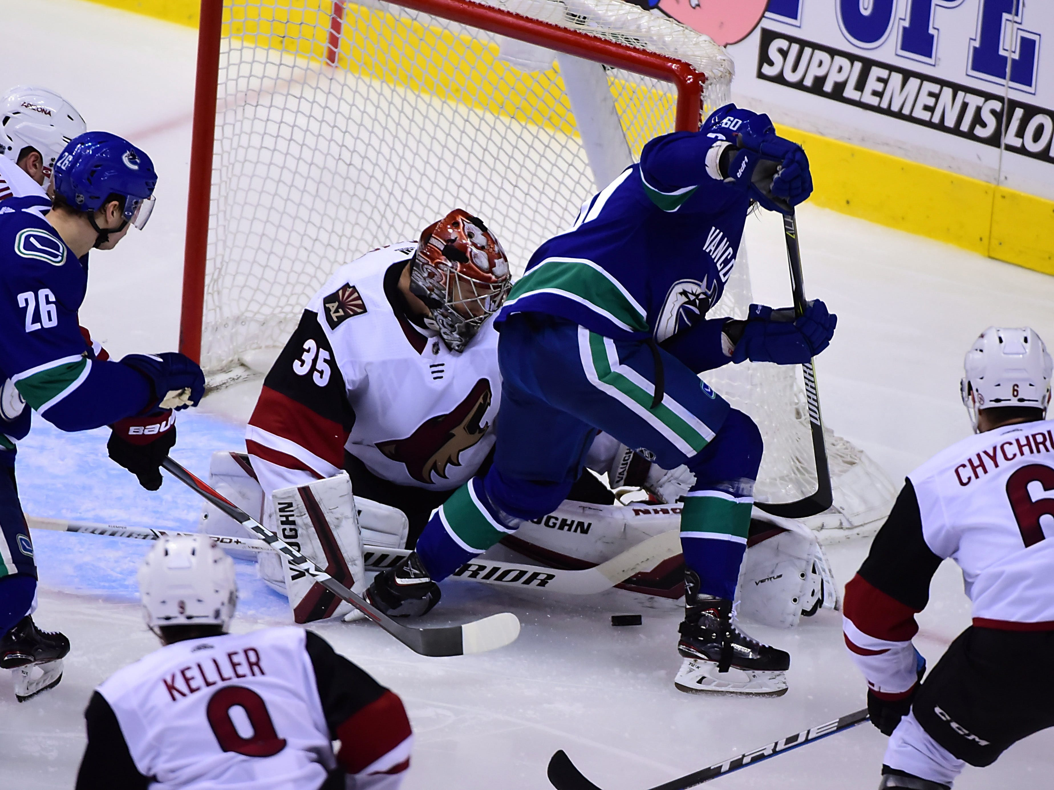 Jan 10, 2019; Vancouver, British Columbia, CAN; Arizona Coyotes goaltender Darcy Kuemper (35) blocks a shot by Vancouver Canucks forward Markus Granlund (60) during the second period at Rogers Arena. Mandatory Credit: Anne-Marie Sorvin-USA TODAY Sports