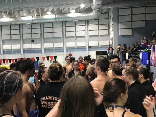 The Palmyra boys and girls swim teams joined together in celebration after sweeping Lower Dauphin on Thursday and moving both teams closer to winning the Mid-Penn Keystone Division title.