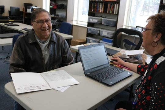 Port Clinton resident Gilbert Carrisales, a U.S. Navy veteran, gets resume tips from an Ohio Means Job employment specialist at the Ida Rupp Public Library on Friday.