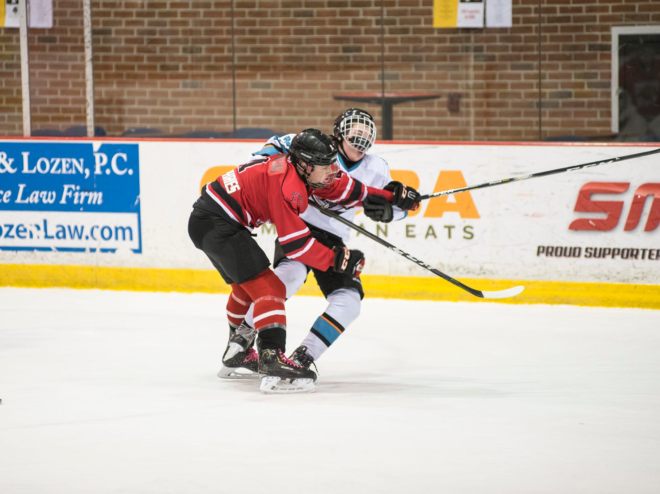 Owen Sound Jr. Attack defenseman Landen Humphries (front) hits Nickel City Sharks forward Brek Morrow  during their Silver Stick Finals BMA match Friday, Jan. 11, 2019 at McMorran Arena.