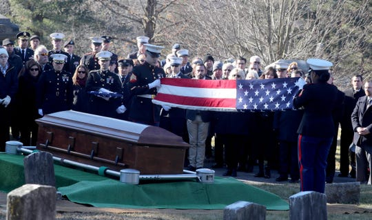An honor guard of U.S. Marines folds the American Flag that draped the casket of U.S. Marine Corps Major James Brophy during a burial service at the Poughkeepsie Rural Cemetery Jan. 11, 2019. The burial followed a funeral service at the Majed J. Nesheiwat Convention Center in Poughkeepsie. Brophy was killed in a collision of two military planes off the coast oh Japan in December.