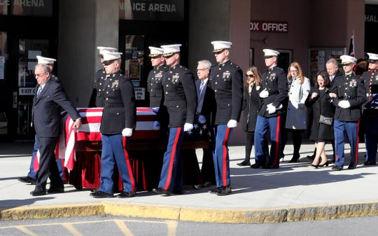 The casket of U.S. Marine Corps Maj. James Brophy is carried from the Majed J. Nesheiwat Convention Center in Poughkeepsie after a funeral service Jan. 11, 2019. Following the casket was Brophy's widow, Erica, and mother, Virginia. Brophy was killed in a collision of two military planes off the coast of Japan in December.