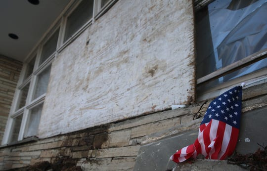 An American flag sits in front of 1140 Main St. in the Village of Fishkill, where a man drove a truck into the building and died. An investigation indicates he suffered a medical emergency, according to the Dutchess County Sheriff's Office.