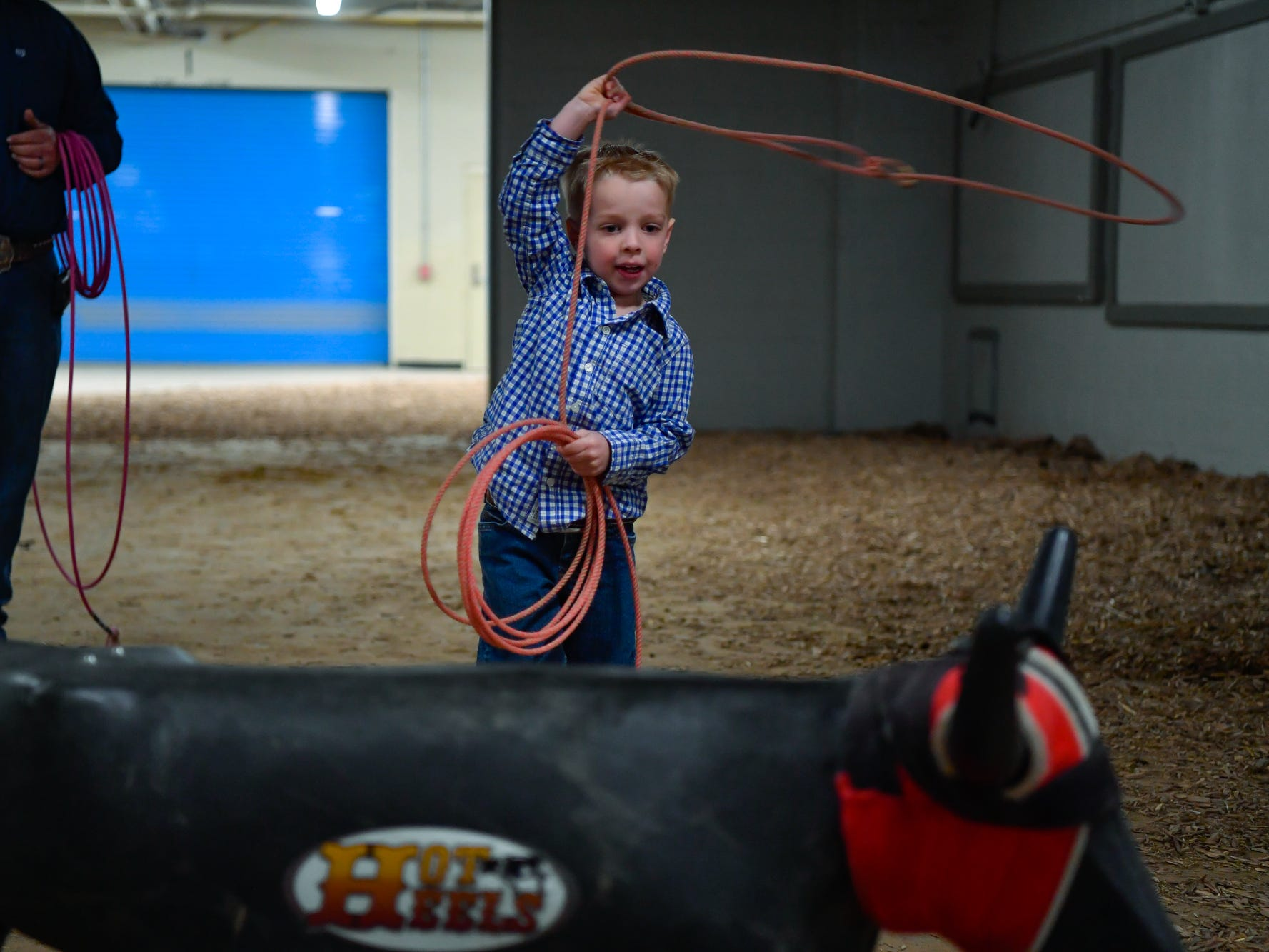 J.W. Healy, 4, of New London PA, practices his roping skills before the first night of the PRCA First Frontier Circuit Finals Rodeo at the 103rd PA Farm Show, Thursday, January 10, 2019.