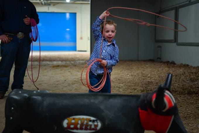 J.W. Healy, 4, of New London PA, practices his roping skills before the first night of the PRCA First Frontier Circuit Finals Rodeo at the 103rd PA Farm Show, Thursday, January 10, 2019.John A. Pavoncello photo