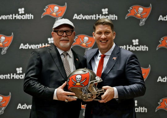 New Tampa Bay Buccaneers head coach Bruce Arians, left, smiles as he stands with general manager Jason Licht after Arians was introduced during a news conference Thursday, Jan. 10, 2019, in Tampa, Fla. (AP Photo/Chris O'Meara)