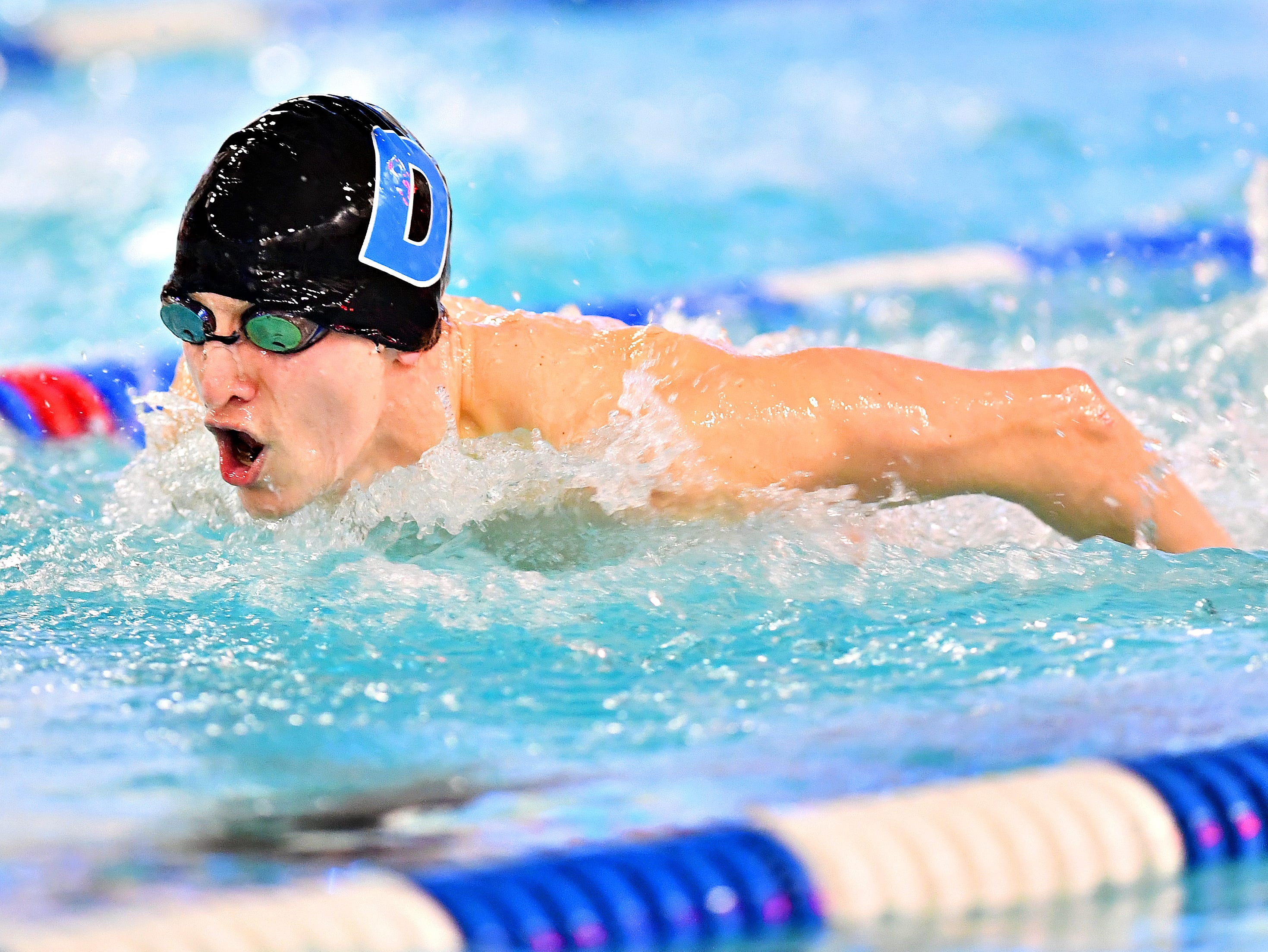 Dallastown's Joel Dunnigan competes in the 100 Yard Butterfly event during swimming action against Central York at Dallastown Area High School in York Township, Thursday, Jan. 10, 2019. Dawn J. Sagert photo