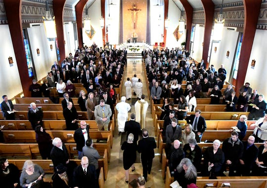 """Friends, family, York City and community leaders attended a service for Douglas Knight at St. Joseph's Catholic Church in Dallastown Friday, Jan. 11, 2019. Knight, 46, who died Jan. 4, was """"York City's cheerleader"""" according to his obituary. Bill Kalina photo"""