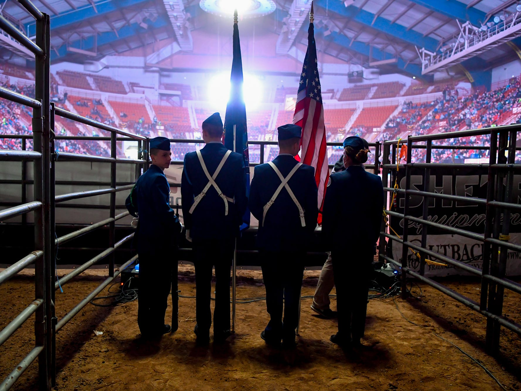 Central York High School Air Force JROTC color guard Michael Sandacz, left, Zach Eisenhart, Elijah Perez and Alina Arechiga, right, wait to enter the arena on the first night of the PRCA First Frontier Circuit Finals Rodeo at the 103rd PA Farm Show, Thursday, January 10, 2019.