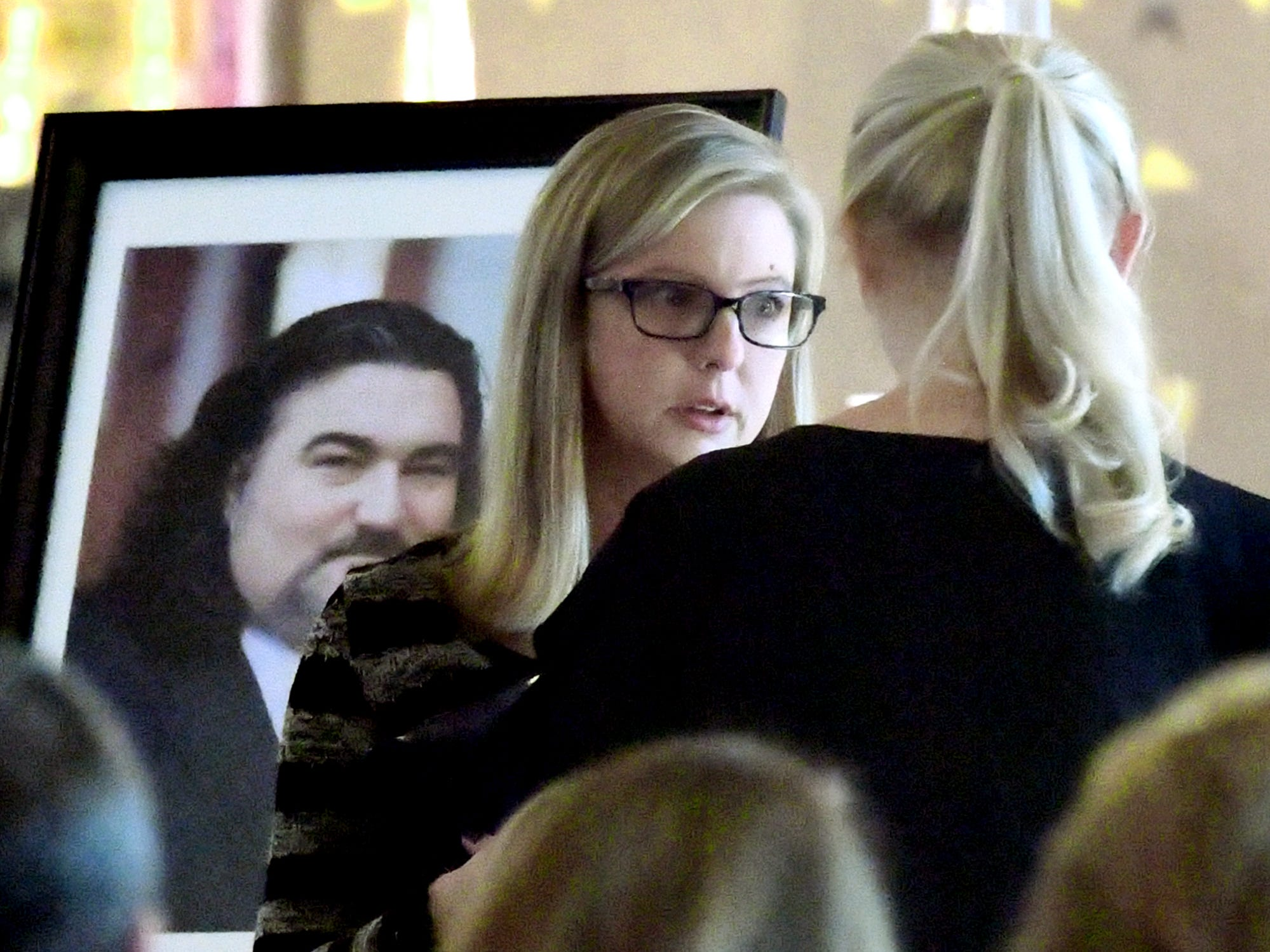 "Jaclyn Stevens of Mount Airy, Md., talks with a guest during a service for Doug Knight, at St. Joseph's Catholic Church in Dallastown Friday, Jan. 11, 2019. Stevens is a first cousin to Knight, 46, who died Jan. 4. He was ""York City's cheerleader"" according to his obituary. Bill Kalina photo"
