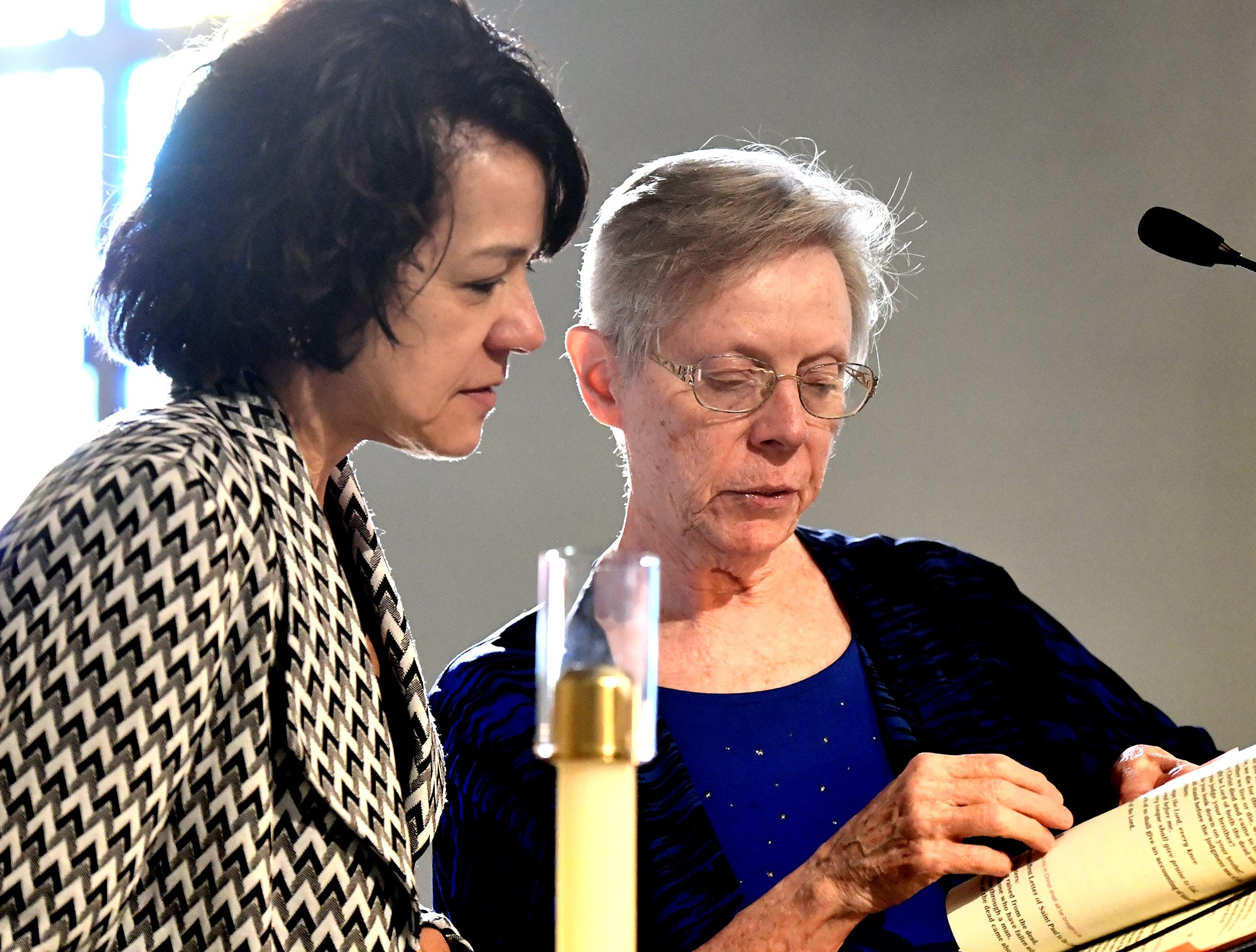 "Charlene Wysocki, left, talks with cantor Kathy Barnes before a service for Doug Knight, at St. Joseph's Catholic Church in Dallastown Friday, Jan. 11, 2019. Wysocki was a reader during the ceremony. Knight, 46, who died Jan. 4,  was ""York City's cheerleader"" according to his obituary. Bill Kalina photo"