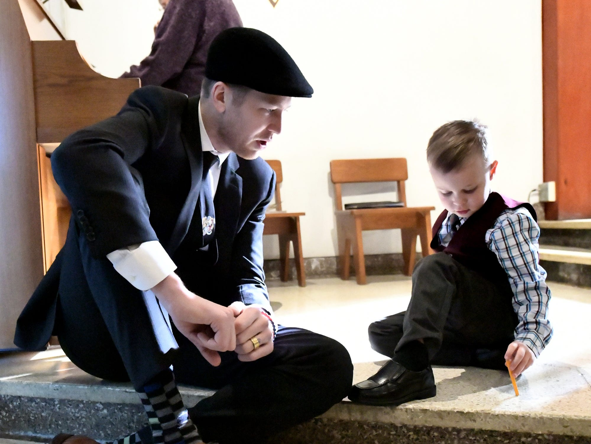 "Brett Leonhardt of Washington, D.C. talks with his cousin Tallen Stevens, 4, of Mount Airy, Md., before a service for Doug Knight at St. Joseph's Catholic Church in Dallastown Friday, Jan. 11, 2019. Leonhardt is a brother-in-law of Knight, 46, who died Jan. 4. He was ""York City's cheerleader"" according to his obituary. Bill Kalina photo"