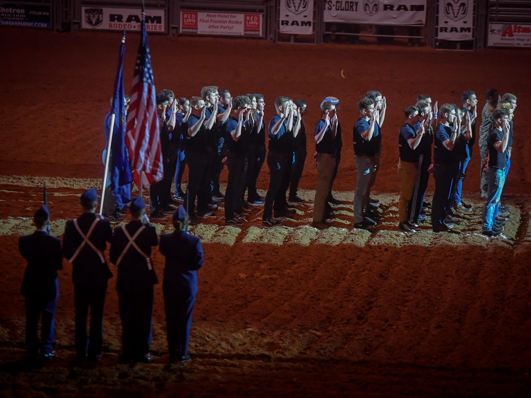 Nearly 50 recruits, Air Force and Marine, take part in a swearing-in ceremony in the New Holland Arena before the PRCA First Frontier Circuit Finals Rodeo at the 103rd PA Farm Show, Thursday, January 10, 2019.