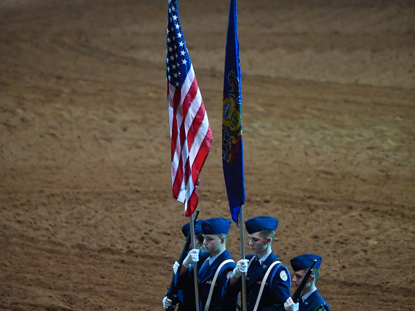Central York High School Air Force JROTC color guard Alina Arechiga, left, Elijah Perez, Zach Eisenhart and Michael Sandacz, right, march out of the arena following the National Anthem on the first night of the PRCA First Frontier Circuit Finals Rodeo at the 103rd PA Farm Show, Thursday, January 10, 2019.