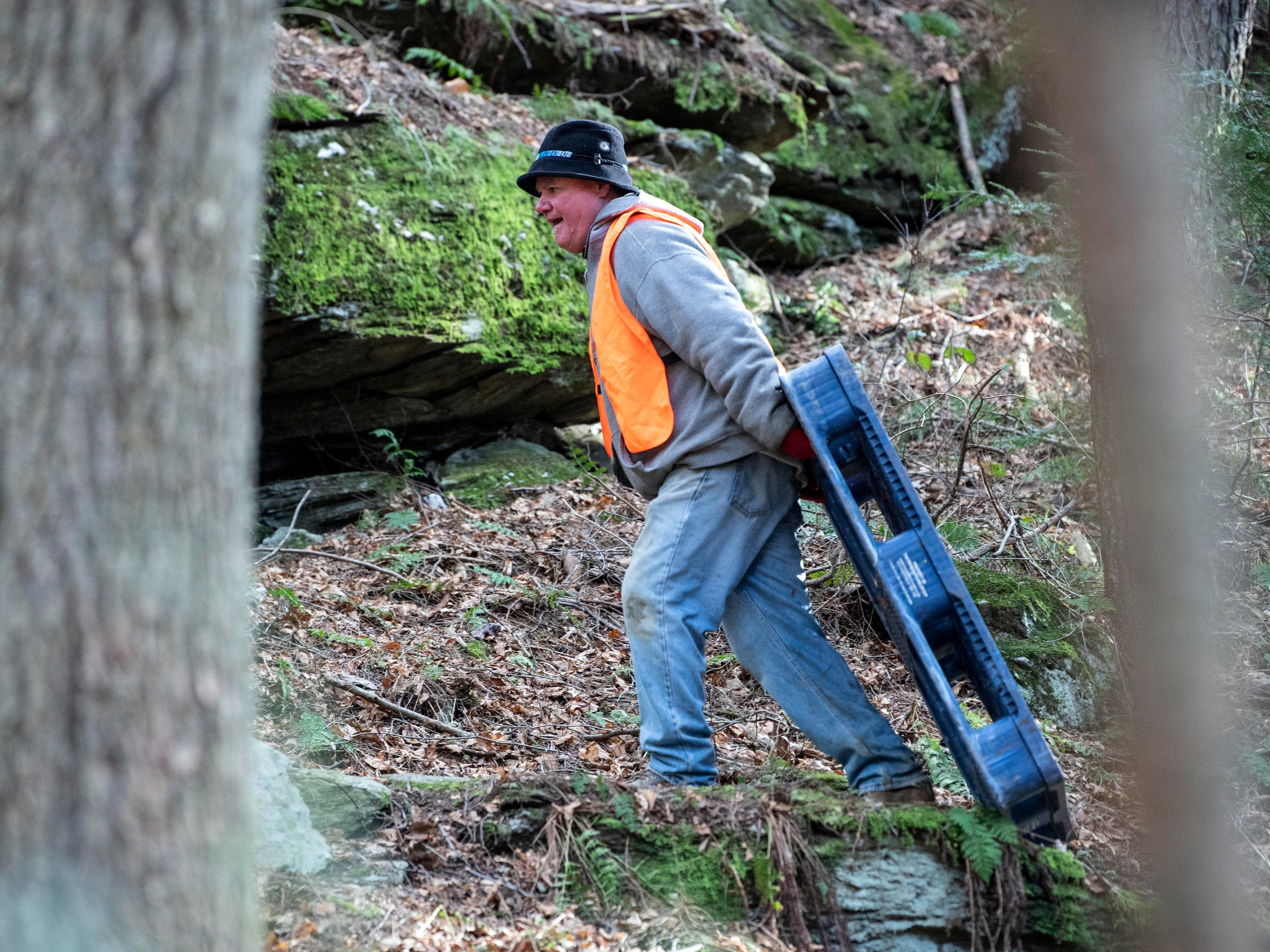 Kirk Piper, who was volunteering all day to help clean up the river, pulls a plastic pallet up the trail, Thursday, Jan. 10, 2019. Flooding that ravaged many parts of York County in Aug. 2018 swept debris into Otter Creek, in Airville.