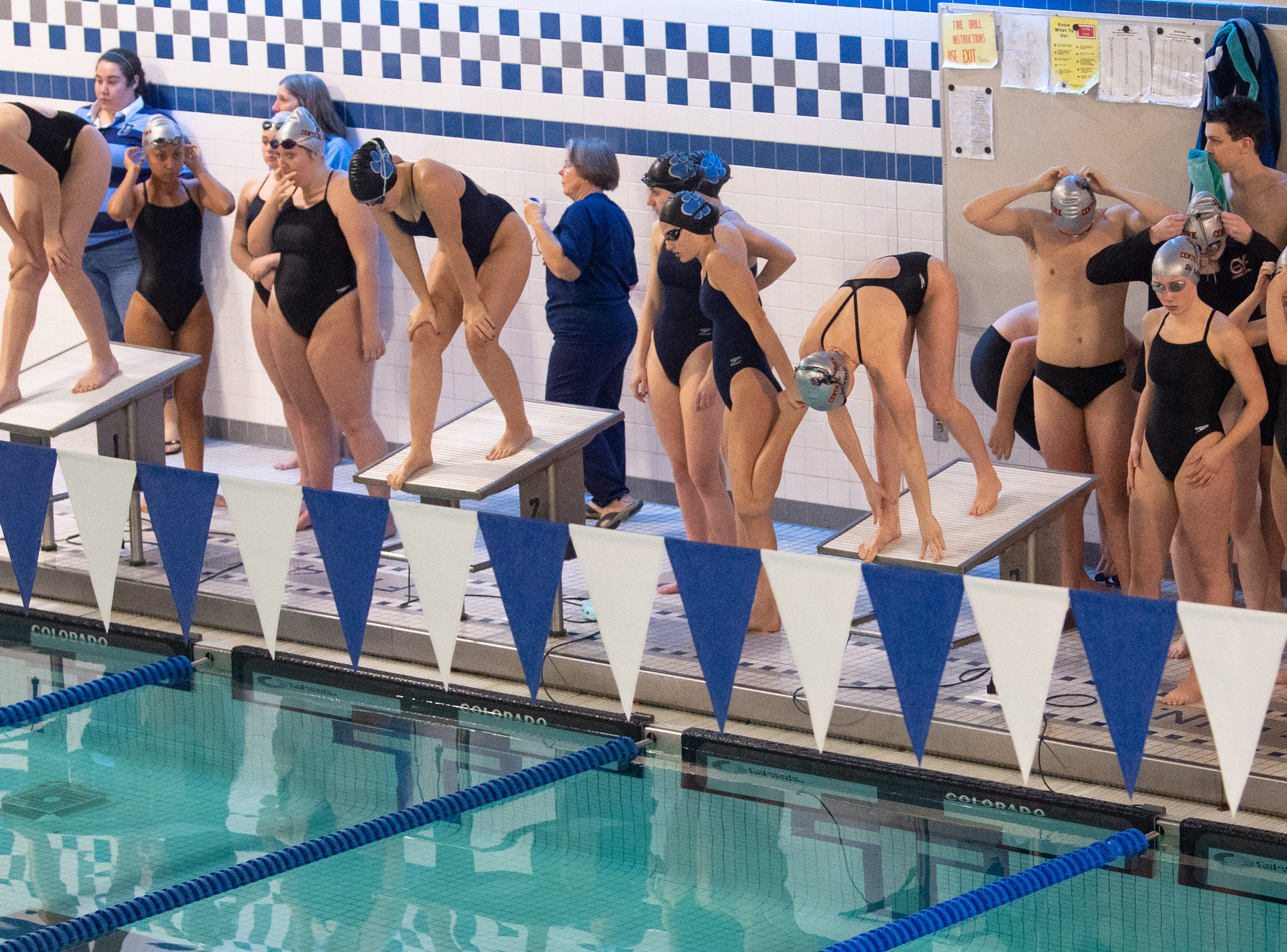 The girls prepare to compete in the 200 Yard Freestyle Relay during the boys' and girls' swim meet between Dallastown and Central York, January 10, 2019. The Panthers defeated the Wildcats 93 to 77 and the Lady Panthers defeated the Lady Wildcats 96 to 74.