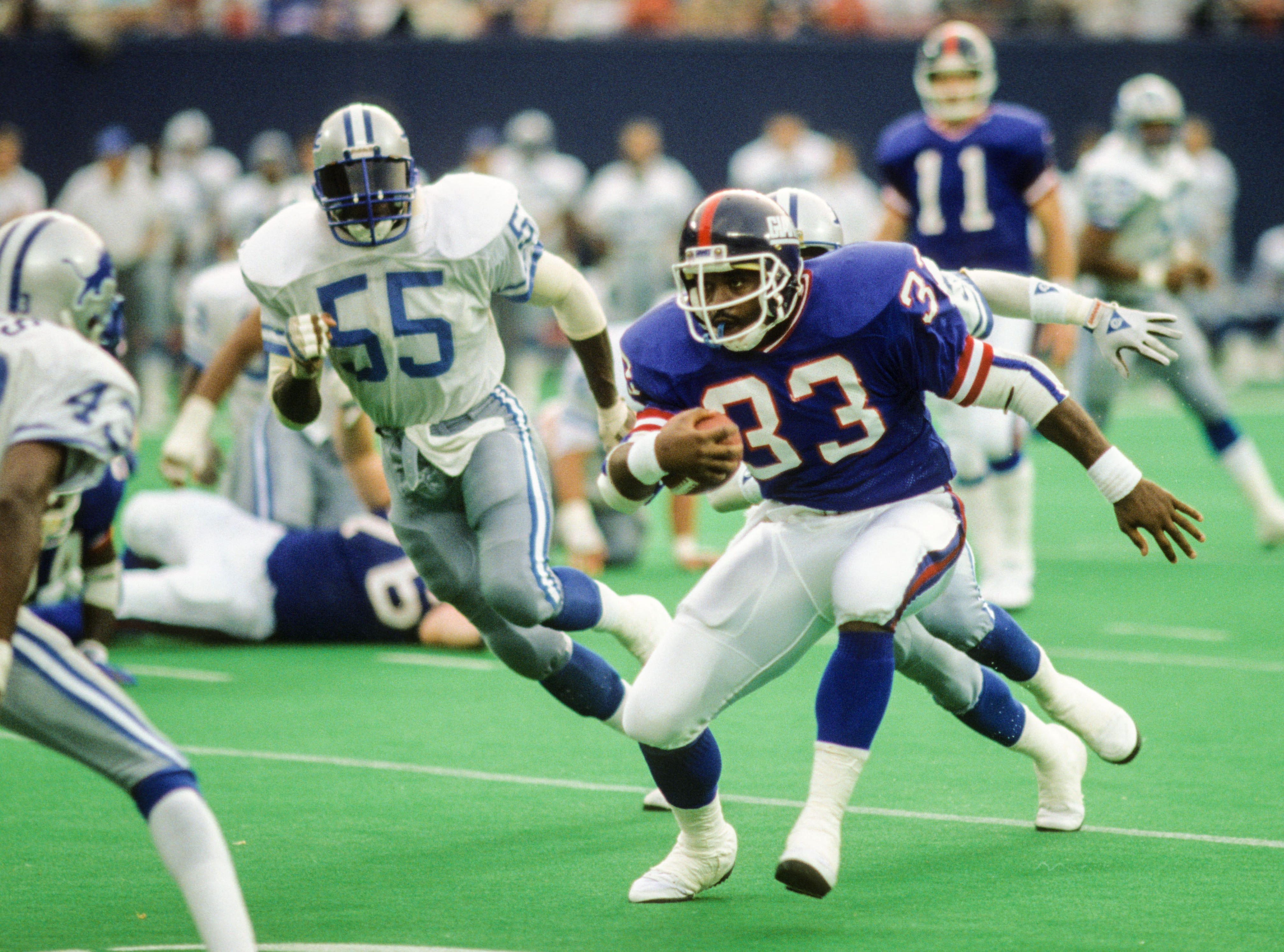 Sep 17, 1989; East Rutherford, NJ, USA; FILE PHOTO; New York Giants running back George Adams (33) in action against Detroit Lions linebacker Mike Cofer (55) at Giants Stadium. Mandatory Credit: Lou Capozzola-USA TODAY NETWORK