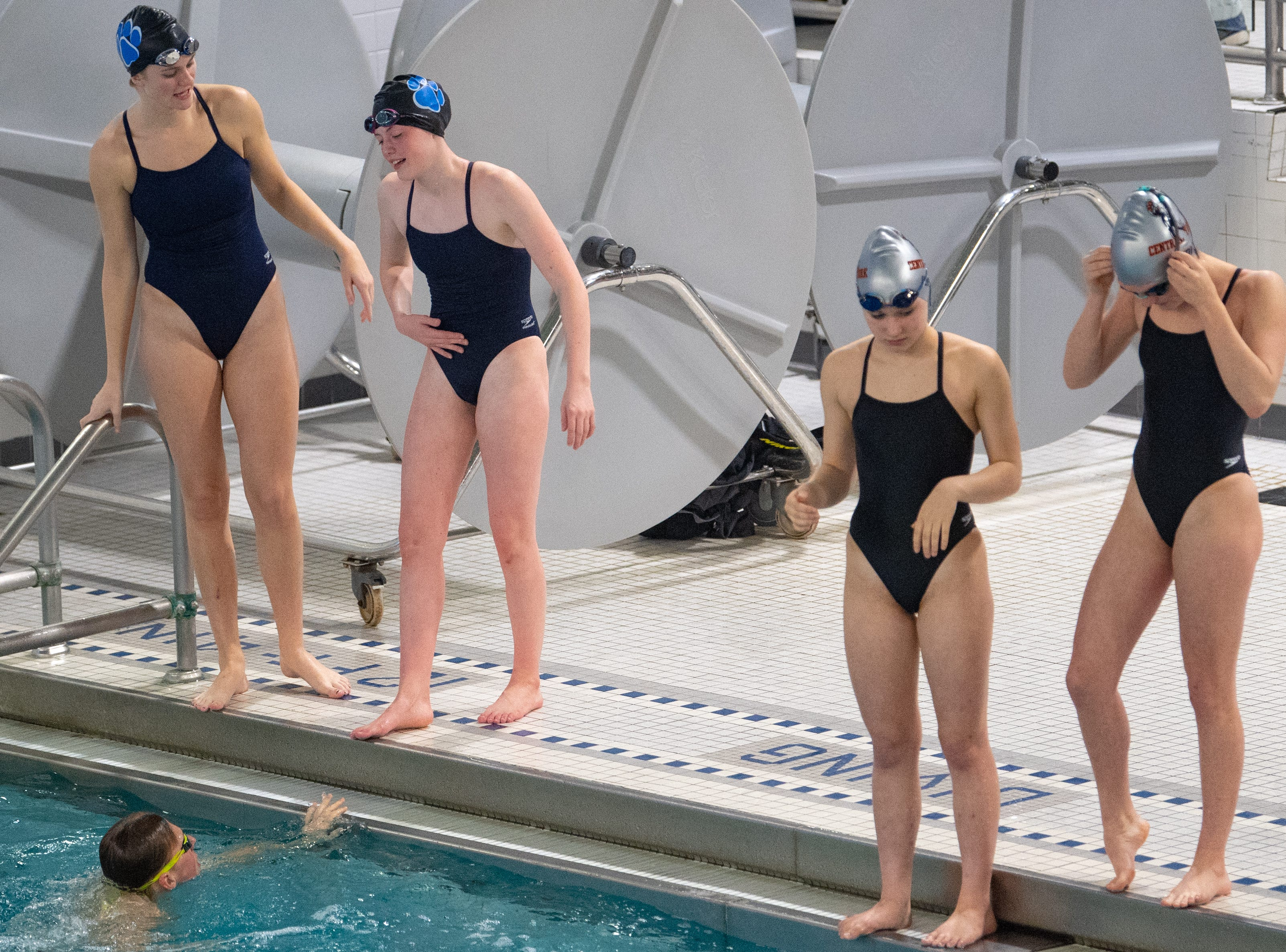 Dallastown and Central York warm up before their race in the practice pool during the boys' and girls' swim meet, January 10, 2019. The Panthers defeated the Wildcats 93 to 77 and the Lady Panthers defeated the Lady Wildcats 96 to 74.