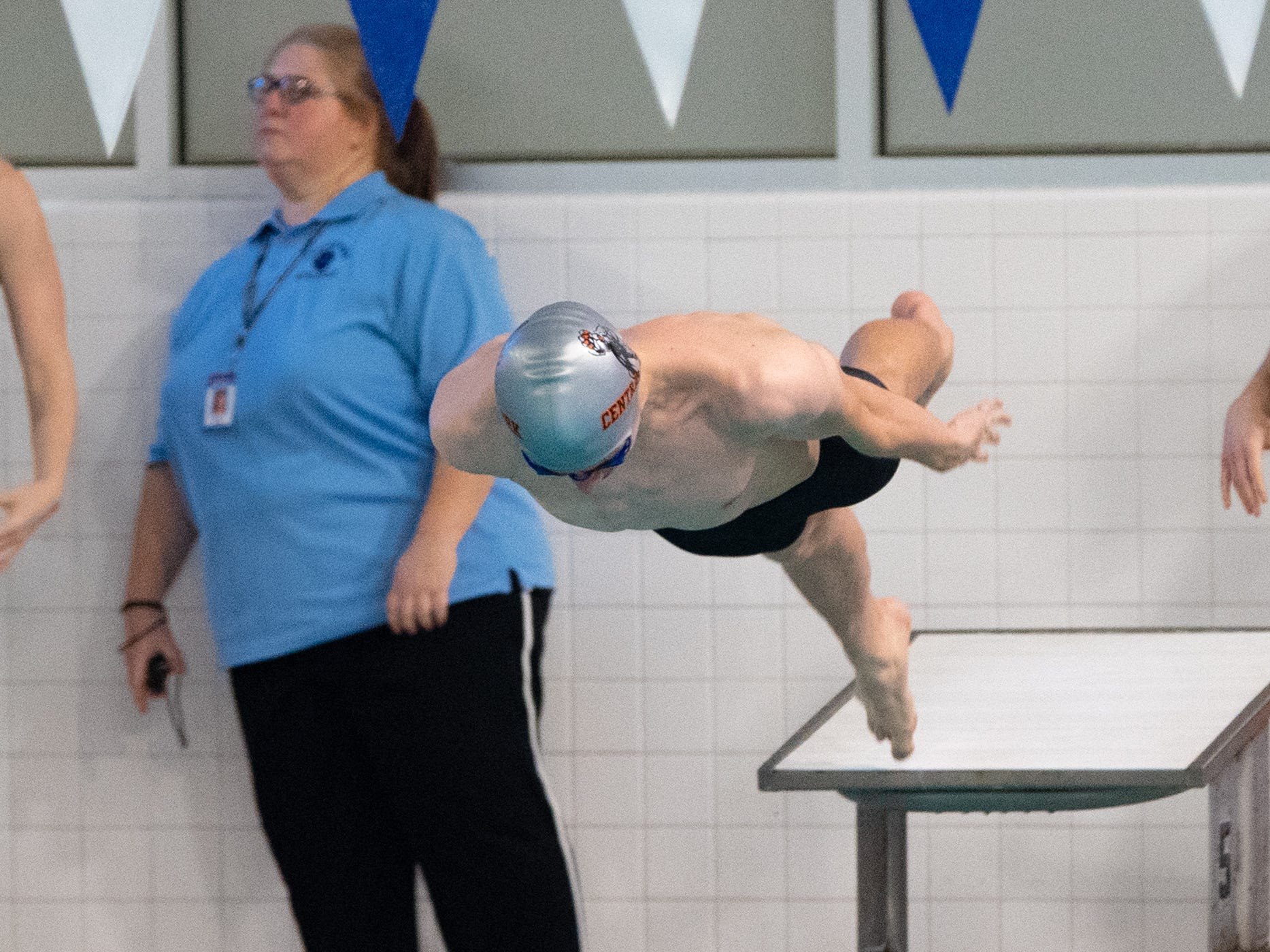 Cody Beck flies off of the starting platform during the boys' and girls' swim meet between Dallastown and Central York, January 10, 2019. The Panthers defeated the Wildcats 93 to 77 and the Lady Panthers defeated the Lady Wildcats 96 to 74.