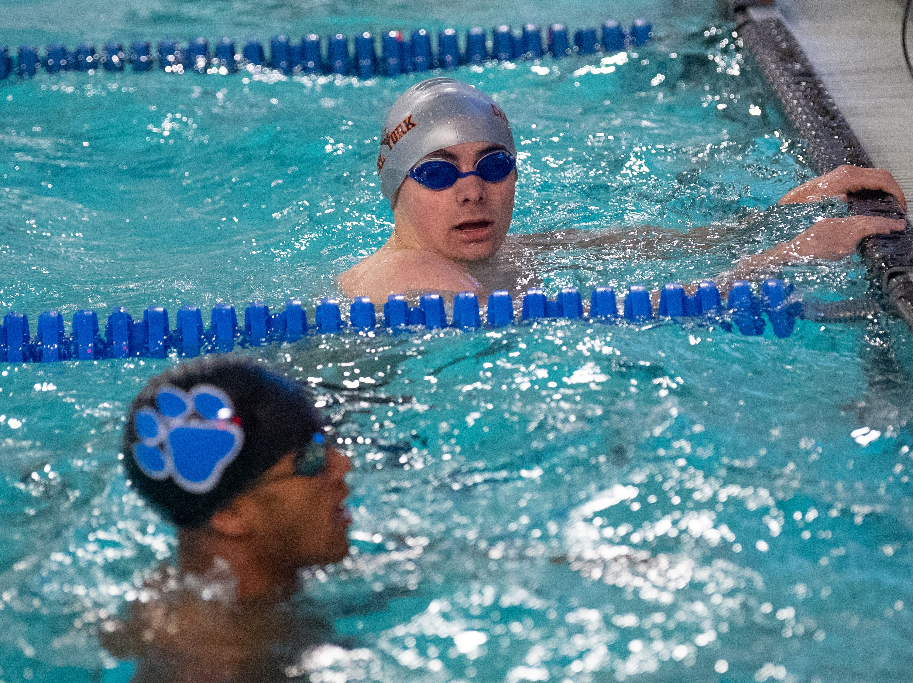Cody Beck finishes the third leg of the relay behind Dallastown during the boys' and girls' swim meet, January 10, 2019. The Panthers defeated the Wildcats 93 to 77 and the Lady Panthers defeated the Lady Wildcats 96 to 74.