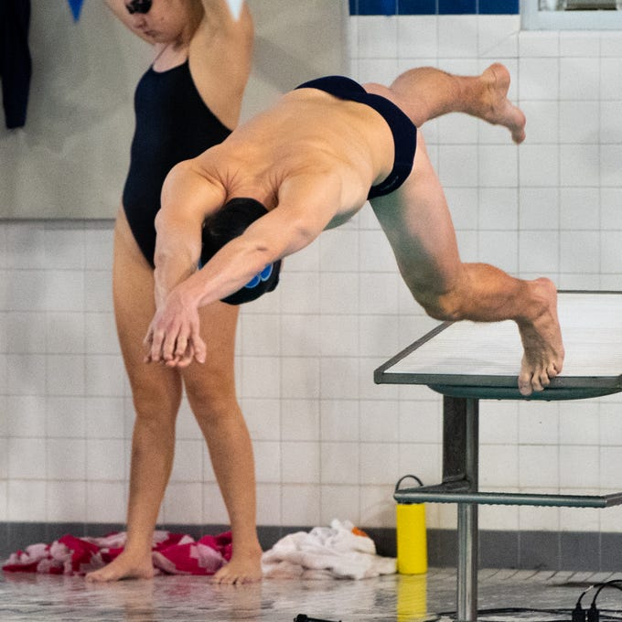 William Cornish of Dallastown leaps into the water during the boys' and girls' swim meet between Dallastown and Central York, January 10, 2019. The Panthers defeated the Wildcats 93 to 77 and the Lady Panthers defeated the Lady Wildcats 96 to 74.