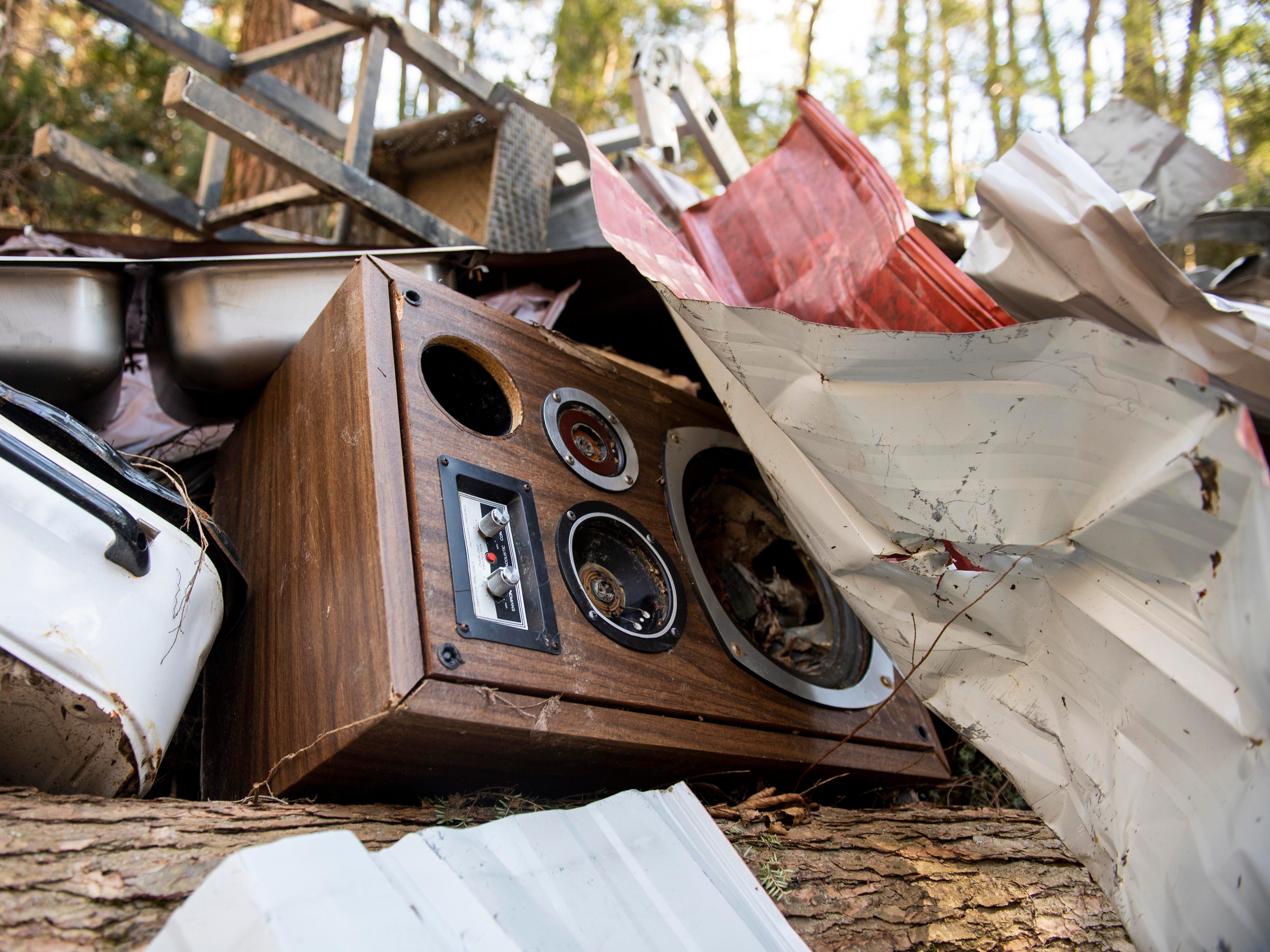 A stereo, among plenty of other miscellaneous metal, are seen in a pile along the banks of Otter Creek, Thursday, Jan. 10, 2019. Flooding that ravaged many parts of York County in Aug. 2018 swept debris into Otter Creek, in Airville.