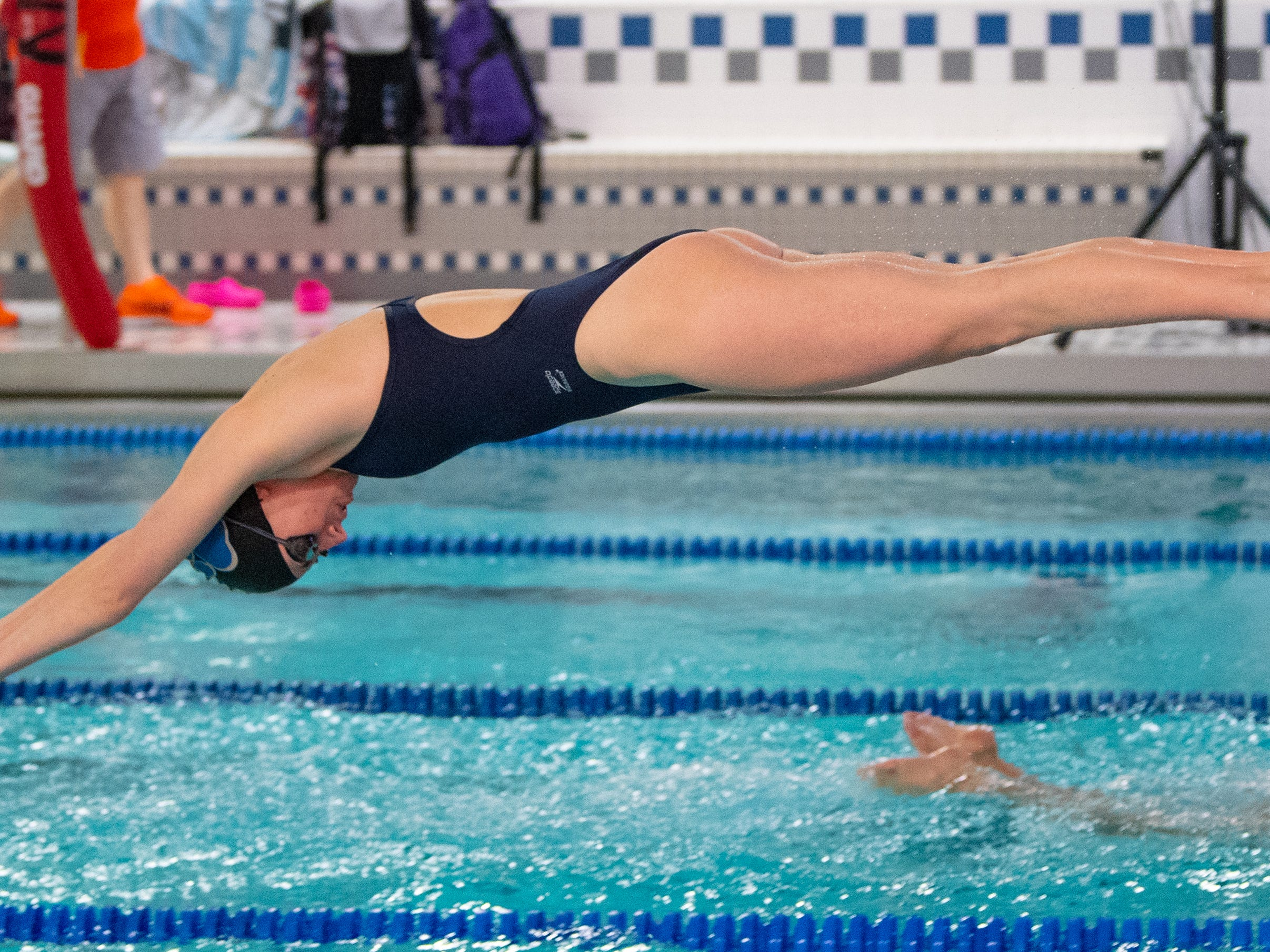 Taylar Myers focuses on her form during the boys' and girls' swim meet between Dallastown and Central York at Dallastown Area High School, January 10, 2019. The Panthers defeated the Wildcats 93 to 77 and the Lady Panthers defeated the Lady Wildcats 96 to 74.