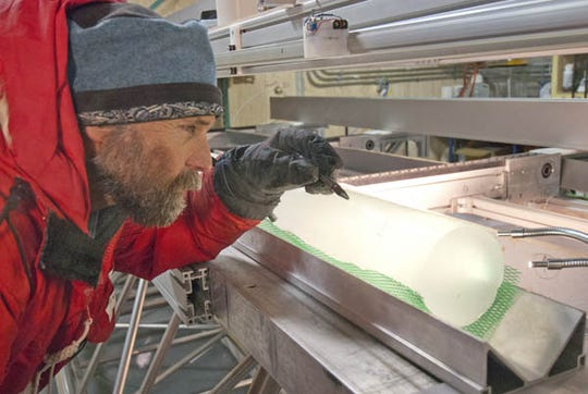 Kendrick Taylor examines an ice core.