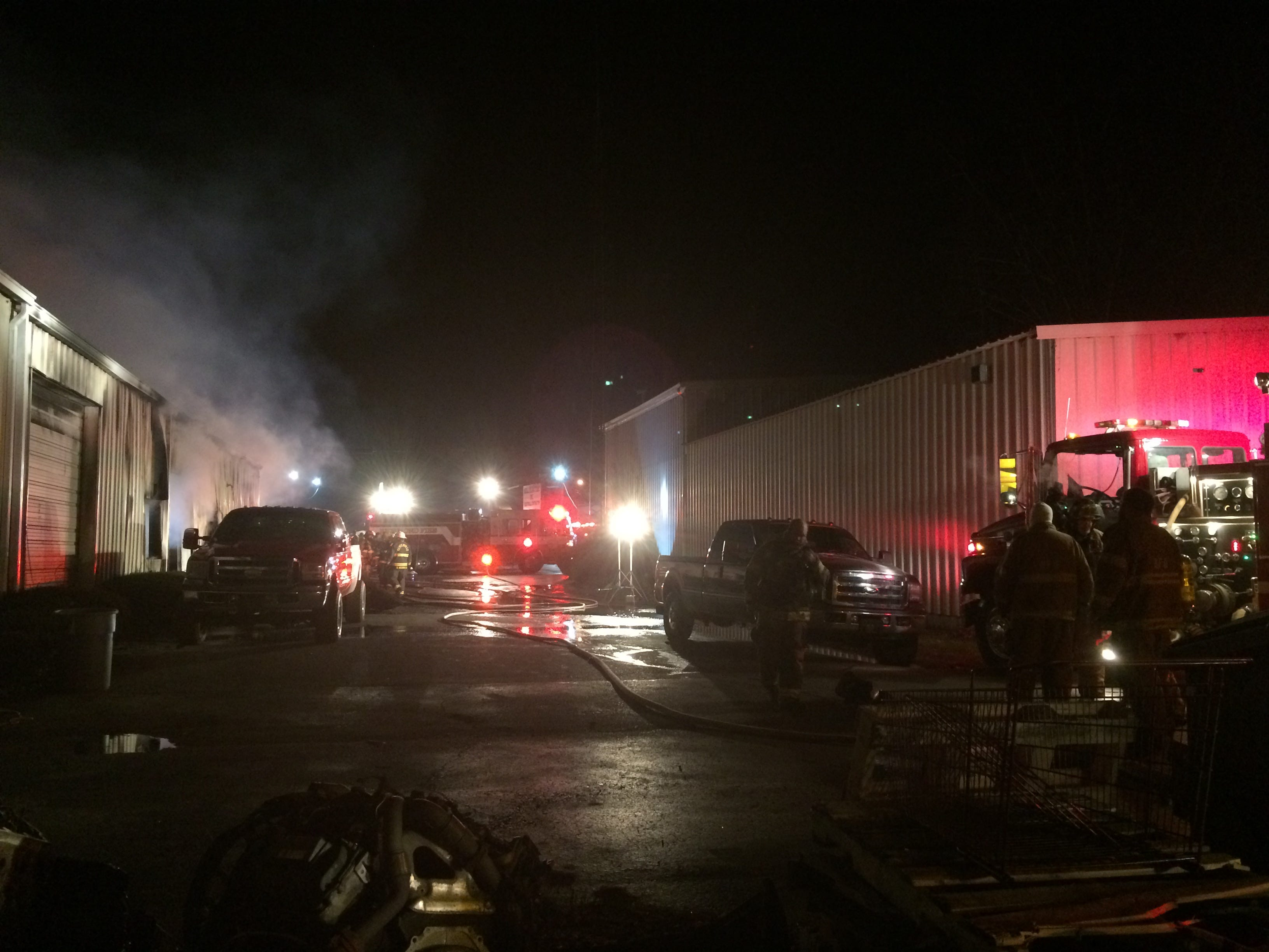 Firefighters extinguish fire at Red Diamond Diesel repair shop on National Road West