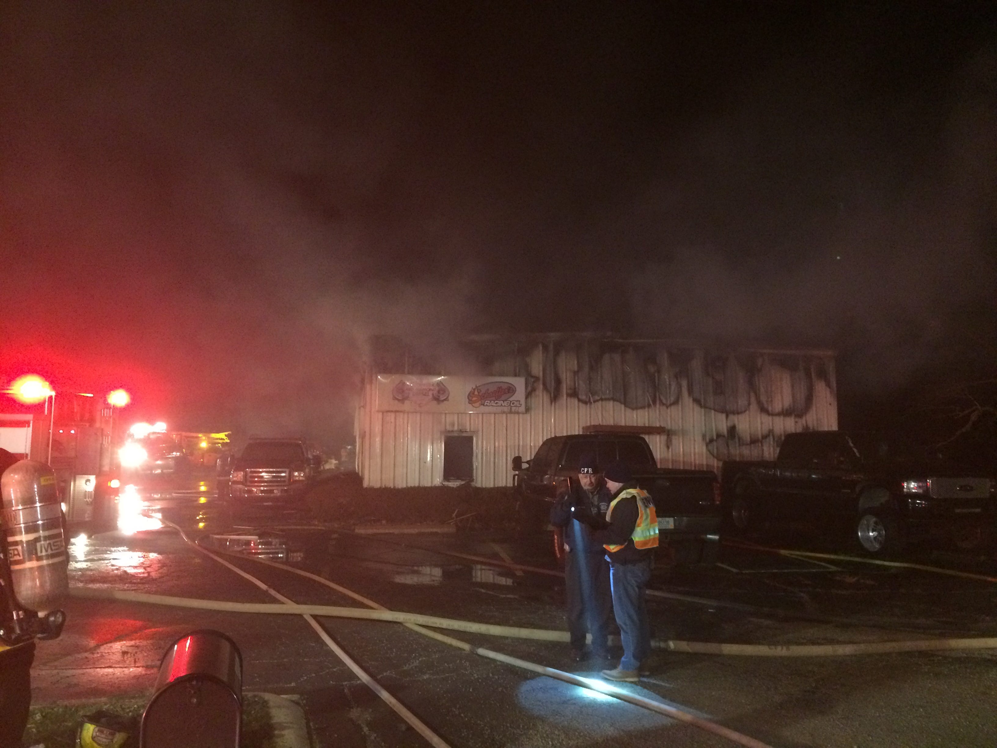 Centerville Fire/Rescue Chief Dennis Spears and Wayne County Emergency Management Agency Director Matthew Cain discuss Thursday night's fire at Red Diamond Diesel repair shop.