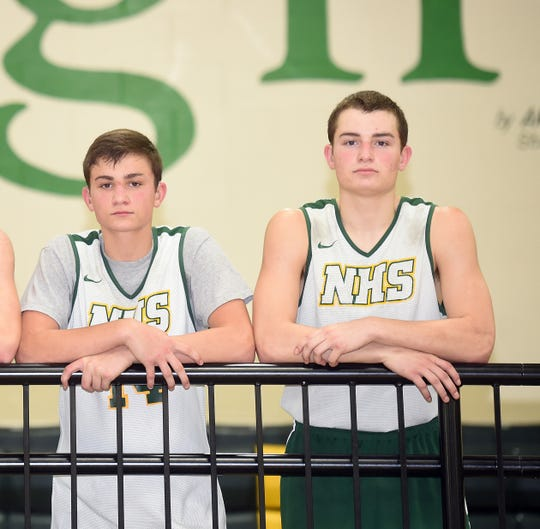 Northeastern High School basketball senior Cole Mikesell, left, and his older brother Kaleb, a 2017 graduate and now a sophomore at Indiana University East, were both born with bilateral hearing loss.