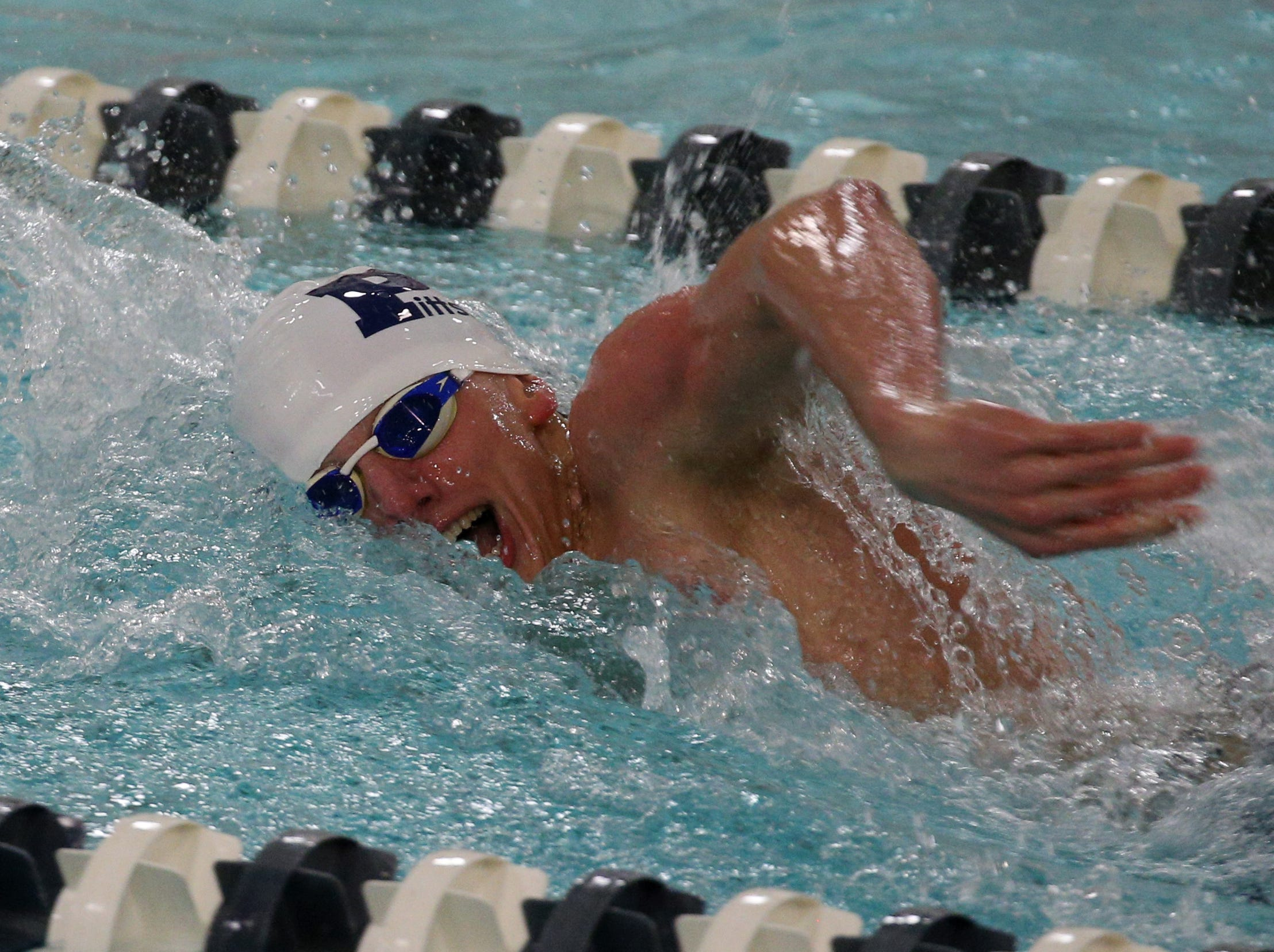 Pittsford's Liam  Murphy swims the 100-yard freestyle against Fairport..