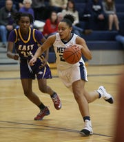 East's Shariona Blocker defends against Mercy's Traiva Breedlove during a game last season.