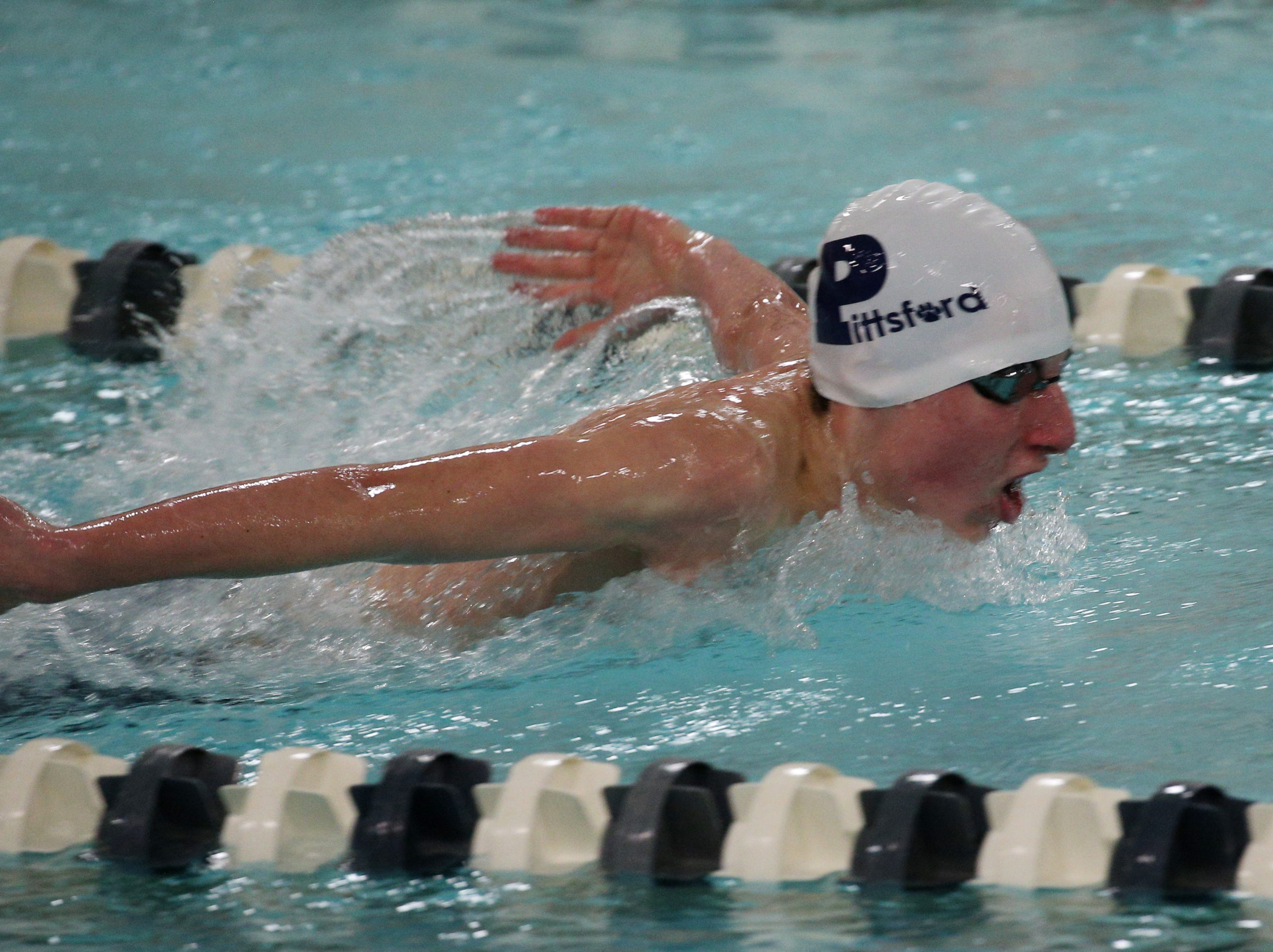 Pittsford's Neil Mortimer swims the 100-yard butterfly against Fairport..