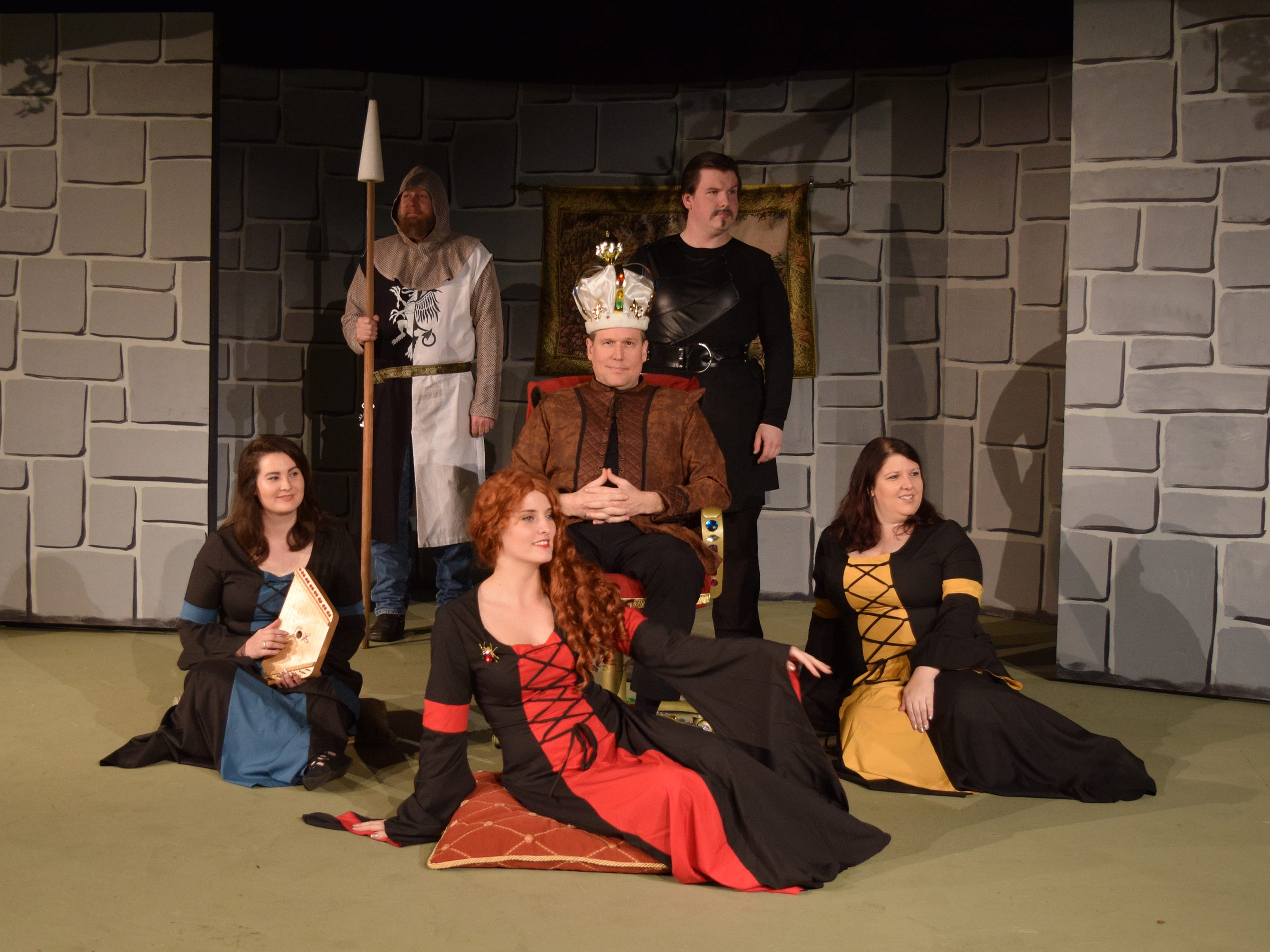 Prince John (Sean Sampson) is surrounded by the Fawning Ladies and backed by the palace guard and the Sheriff of Nottingham (Keith Rose).