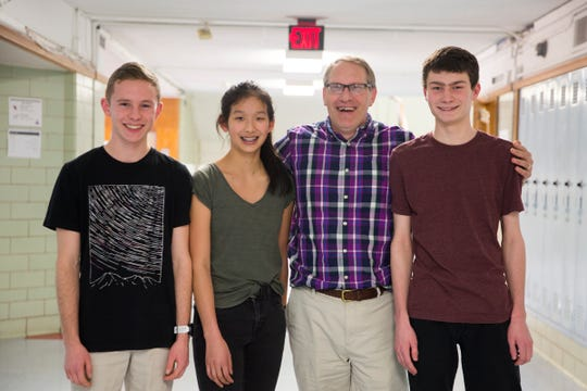 South Salem High School juniors Ned Harlan, Julie Chen and Mason Obery pose with their math teacher and supervisor Warren Trotter on Friday, Jan. 11, 2019. The students are preparing to compete in a Samsung STEM competition in which they are making a drone that would alert officials of dangerous algae levels in Detroit Lake.