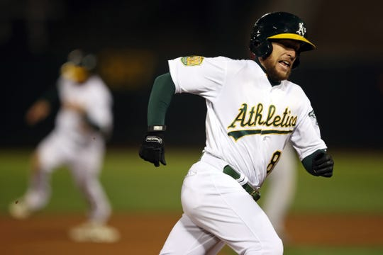 Sep 18, 2018; Oakland, CA, USA; Oakland Athletics second baseman Jed Lowrie (8) rounds third base on the way to score a run during the eighth inning against the Los Angeles Angels at Oakland Coliseum. Mandatory Credit: Darren Yamashita-USA TODAY Sports