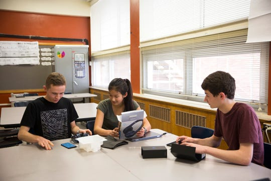 South Salem High School juniors (from left to right) Ned Harlan, Julie Chen and Mason Obery prepare to compete in a Samsung STEM competition after school in Salem on Friday, Jan. 11, 2019. They were chosen to represent Oregon for their project that uses a drone to identify algae levels in Detroit Lake.