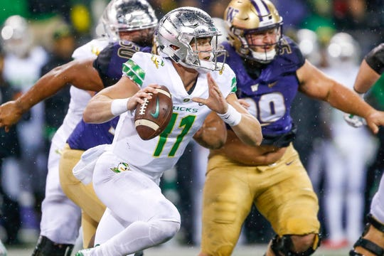 Nov 4, 2017; Seattle, WA, USA; Oregon Ducks quarterback Braxton Burmeister (11) looks to pass against the Oregon Ducks during the second quarter at Husky Stadium. Mandatory Credit: Jennifer Buchanan-USA TODAY Sports
