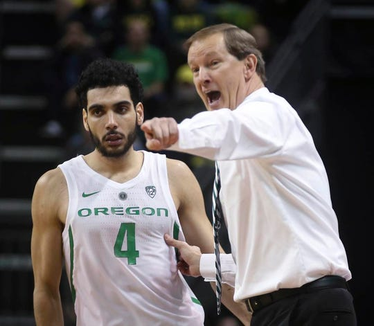 Oregon coach Dana Altman, right, calls instructions to Ehab Amin during the second half of an NCAA college basketball game UCLA on Thursday, Jan 10, 2019, in Eugene, Ore. (AP Photo/Chris Pietsch)