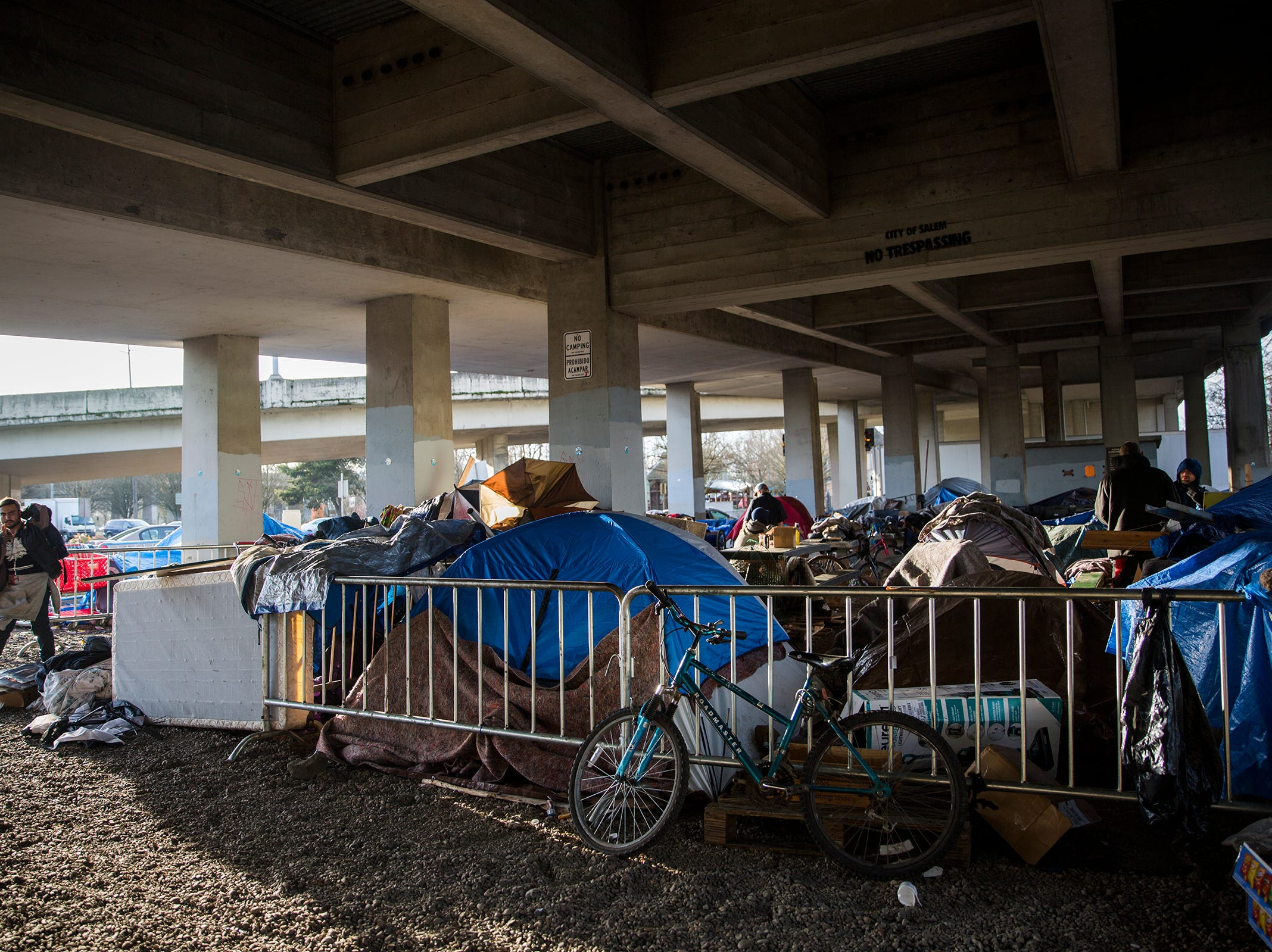 Tents and personal belongings crowd the edge of Marion Square Park under the Marion St. Bridge on Front St. NE in Salem on Thursday, Jan. 10, 2019. Around 15 people spend the night under the bridge each night.