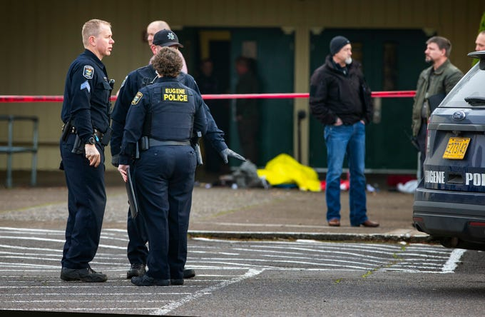 Eugene police secure the scene in front of Cascade Middle School in Eugene, Ore., Friday Jan. 11, 2019, after an officer involved shooting.