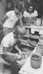 Roger Allen spins the potter's wheel as Bill Rich and Richard Ramirez look on, at the Chicken Farm Art Center in 1976.