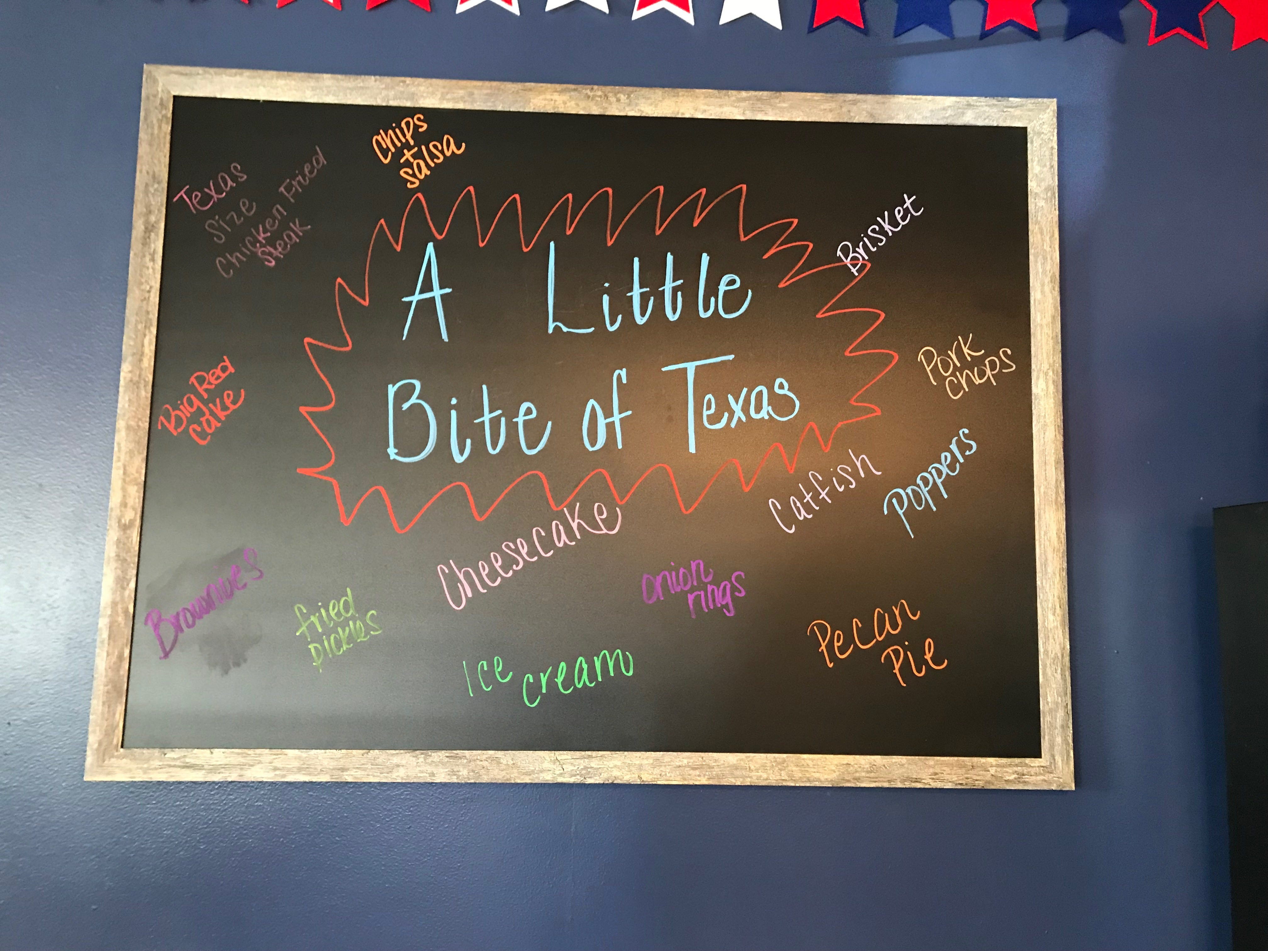 The board at A Little Bite of Texas,1527 East Harris Ave., shows some of their best selling menu items.