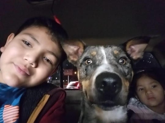 Paris poses with the Natalie and Isaiah Sanchez, the kids of her owner, Darielle Sanchez.