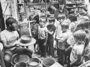 Roger Allen explains the workings of clay pottery to school children in 1982 at the Chicken Farm Art Center.